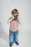 Boy with a camera Stock Image