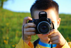 Boy with Camera, Taking Photo Stock Photos