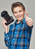 Boy with camera taking pictures. Royalty Free Stock Image