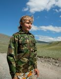 Boy camouflage. Outdoors in the mountains stock images
