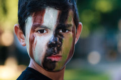 Boy in camouflage Stock Photography