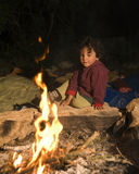 Boy at campfire royalty free stock photo
