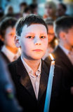Boy with candle Stock Photography