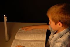 Boy by Candlelight Stock Photography