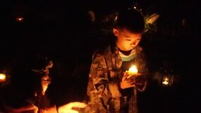 Boy in candlelight Royalty Free Stock Photo