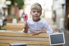 Boy with a candy Royalty Free Stock Images