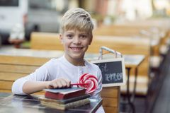 Boy with a candy Royalty Free Stock Photos