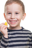 Boy with candy. Cute smiling boy with jelly candy on isolated white Stock Photo