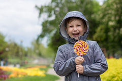 Boy with candy Stock Photography