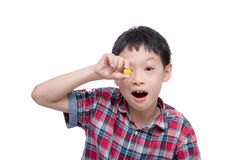 Boy with candy over white Stock Image