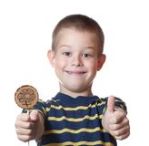 Boy with candy on a stick Stock Photo