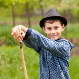 Boy with cane and hat outdoor Royalty Free Stock Images