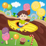 Boy in a canoe floating on a chocolate river Royalty Free Stock Photo