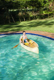 Boy Canoe Pool Royalty Free Stock Photo