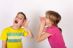 Boy cant hear the sound. Boy cupping his hand behind ear because he cant hear his sister voice royalty free stock photo