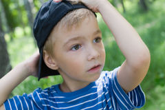 Boy with a cap. Boy wear one's cap on one side Stock Photos