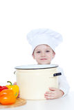Boy in a cap. Of the cook holds a greater saucepan Royalty Free Stock Photo