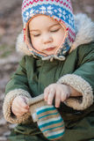 Boy in a cap. With mitten Stock Images