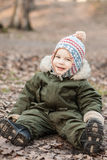 Boy in a cap. With a pompon stock photos
