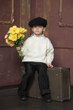 Boy in a cap with a bouquet of flowers Royalty Free Stock Images