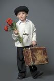 Boy in a cap with a bouquet of flowers Stock Photography