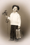 Boy in a cap with a bouquet of flowers Royalty Free Stock Photo