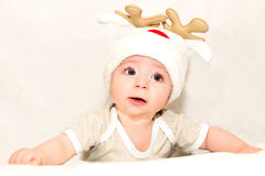 Boy in cap deer Royalty Free Stock Images