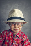 Boy in a cap and glasses Stock Image