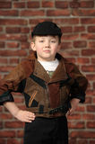Boy in a cap and a leather jacket Stock Images