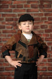 Boy in a cap and a leather jacket Royalty Free Stock Images