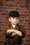 Boy in a cap and a leather jacket Royalty Free Stock Photos