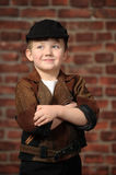 Boy in a cap and a leather jacket Stock Photography