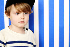 Boy in cap looking away Stock Photography