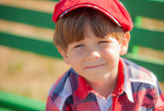 Boy in a cap Stock Images