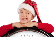 Boy in cap of Santa Claus Stock Image