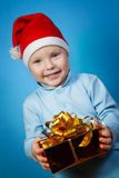 Boy in a cap of Santa Claus with gifts Royalty Free Stock Photo