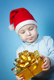 Boy in a cap of Santa Claus with gifts Stock Image