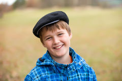 Boy in cap smiling Stock Photo