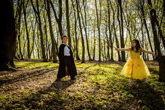 Boy with cape and girl in princess dress Royalty Free Stock Photography