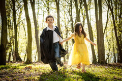 Boy with cape and girl in princess dress Stock Image