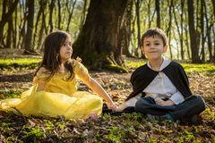 Boy with cape and girl in princess dress Stock Images