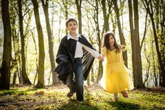 Boy with cape and girl in princess dress Stock Photography
