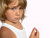 Boy with capsule royalty free stock photo