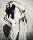 Boy capturing  with retro camera Stock Images