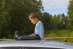 Boy and car Stock Image