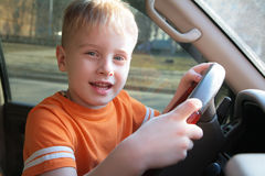 Boy in car Stock Images