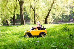 Boy on a car Royalty Free Stock Photo
