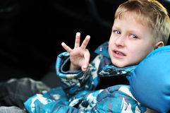 Boy in car-seat royalty free stock photography