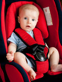Boy in car seat Stock Images