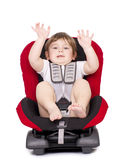 Boy in a car seat. Royalty Free Stock Image